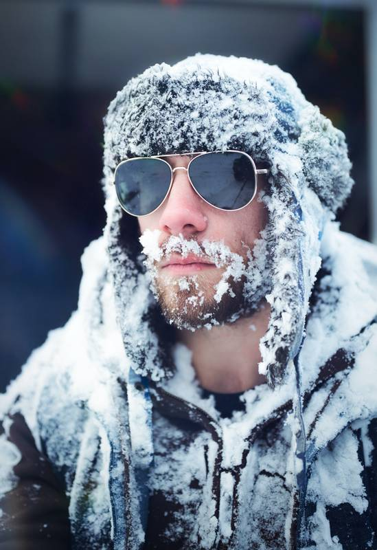 Portrait of a man covered in snow.