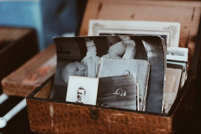 old photos in brown wooden chest