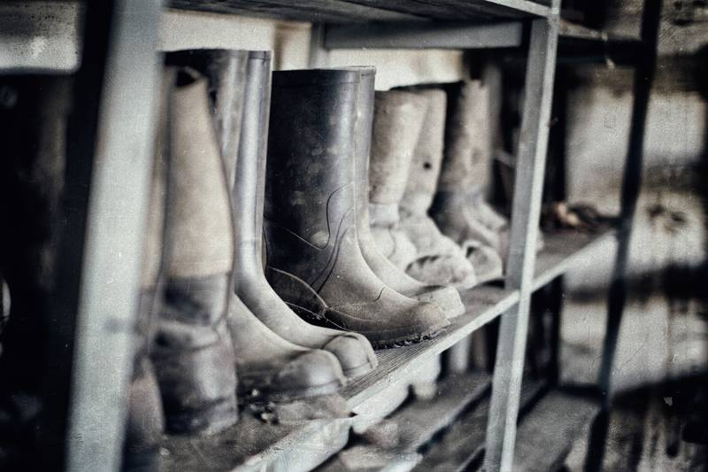 A shelf with safety boots in a lost place